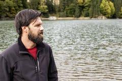 Closeup of young man near a mountain  lake looking Royalty Free Stock Image