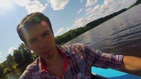 Closeup young man paddling kayak on river, action camera, selfie. Stock footage stock video footage