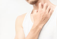Closeup young man scratch the itch on neck with white background Stock Photos