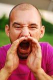 Closeup of a young man screaming Stock Photo