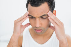 Closeup of a young man suffering from headache Stock Images