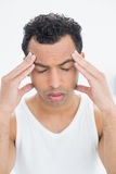 Closeup of a young man suffering from headache Royalty Free Stock Image