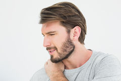 Closeup of a young man suffering from shoulder pain Stock Photography