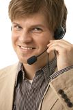 Closeup of young man talking on headset Royalty Free Stock Photo