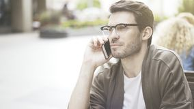 A closeup of young man talking on the phone Stock Image