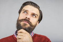 Closeup of young man thinking hard Stock Photography