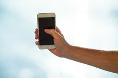 Closeup of young man use smart phone in airport Stock Image