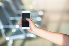 Closeup of young man use smart phone in airport Stock Photos