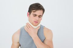 Closeup of a young man wearing cervical collar. Over white background royalty free stock photos