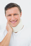 Closeup of a young man wearing cervical collar. Closeup portrait of a young man wearing cervical collar over white background stock photos