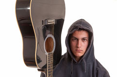 Closeup of young musician with his acoustic guitar. Selective Royalty Free Stock Image