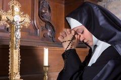 Novice in prayer stock photo