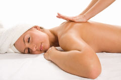 Closeup of young pretty woman receiving massage. Close-up of young woman receiving massage Royalty Free Stock Images