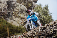Closeup of a young rider athlete on bicycle on a rock royalty free stock photos
