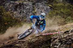 Closeup of a young rider athlete on bike falls royalty free stock photography