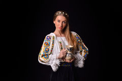 Closeup of a young Romanian woman dressed in traditional costume Royalty Free Stock Photo