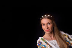 Closeup of a young Romanian woman with wreath of flowers on head Royalty Free Stock Photo