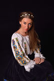 Closeup of a young Romanian woman with wreath of flowers on head Royalty Free Stock Photos