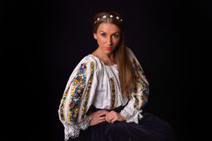Closeup of a young Romanian woman with wreath of flowers on head Royalty Free Stock Images
