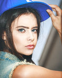 Closeup of Young sexy woman in blue cap Stock Images
