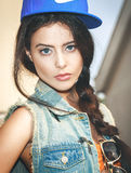Closeup of Young sexy woman in blue cap Stock Photos