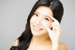 Closeup of young smiling woman eyes with gesture Stock Photo