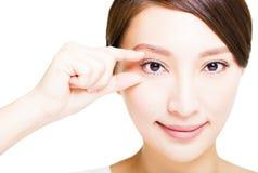 Closeup of young smiling woman eyes makeup Royalty Free Stock Photography