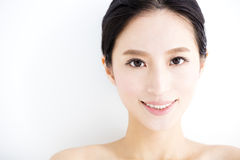 Closeup  young smiling  woman  face Royalty Free Stock Photography