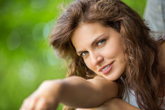 Closeup of young smiling woman Stock Images