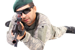 Closeup of young soldier or sniper aiming with a rifle Royalty Free Stock Photo