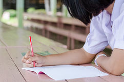 Closeup of  young student hands writing on notebook Royalty Free Stock Photography