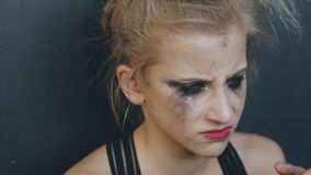 Closeup of young teenage girl dancer crying after loss perfomance sits on floor in dance studio indoors stock footage