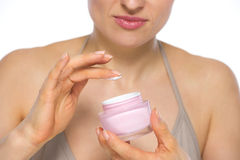 Closeup on young woman applying creme Stock Photos