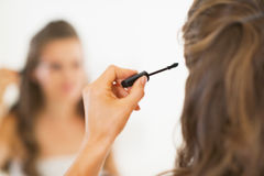 Closeup on young woman applying mascara Royalty Free Stock Image