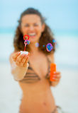 Closeup on young woman blowing soap bubbles Royalty Free Stock Images
