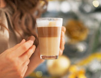 Closeup on young woman with candy and latte macchiato Stock Photography