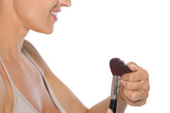 Closeup on young woman checking brush Stock Photos