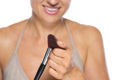 Closeup on young woman checking brush Stock Photo