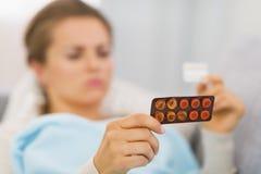 Closeup on young woman choosing pills Royalty Free Stock Photos