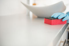 Closeup on young woman cleaning desk in bathroom Royalty Free Stock Image