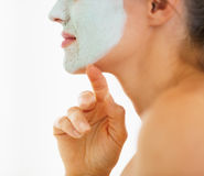 Closeup on young woman with cosmetic mask on face Royalty Free Stock Photos