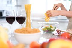 Closeup Young woman cutting slice vegetables making salad healthy food. With fruits cooking menu for dinner with wine glass in kitchen at home Stock Photos