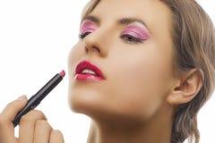 Blond girl doing makeup Royalty Free Stock Photo