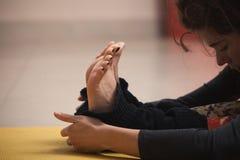 Closeup of young woman doing yoga Royalty Free Stock Photo