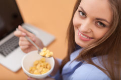 Closeup of young woman eating musli. Royalty Free Stock Photo