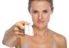 Closeup on young woman giving blistering package of pills Stock Photography