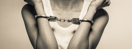 Closeup young woman with handcuffs, violence or internment concept Royalty Free Stock Photography