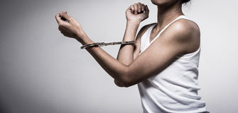 Closeup young woman with handcuffs, violence or internment concept background Royalty Free Stock Photos