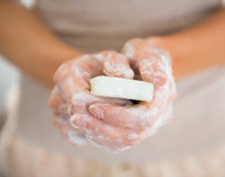 Closeup on young woman hands with soap Stock Images