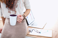 Closeup young woman holding cup of coffee Stock Image